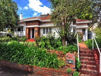 Brick art deco house exterior with brick fence & landscaped garden - House Facade photo 1603145