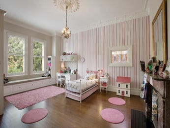 Children's room bedroom design idea with floorboards & sash windows using pink colours - Bedroom photo 1603273