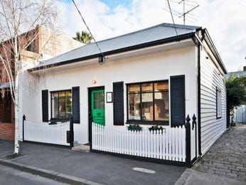 Corrugated iron victorian house exterior with picket fence & window shutters - House Facade photo 525273