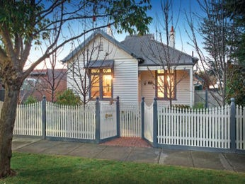 Corrugated iron edwardian house exterior with porch & window awnings - House Facade photo 525937