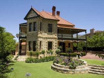 Brick queen anne house exterior with balcony & hedging - House Facade photo 522697