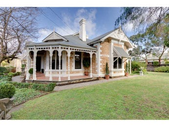 Corrugated iron queen anne house exterior with porch & landscaped garden - House Facade photo 522757