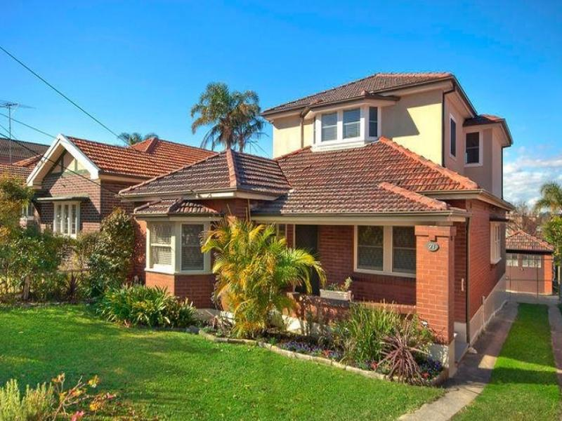 Brick californian bungalow house exterior with porch landscaped