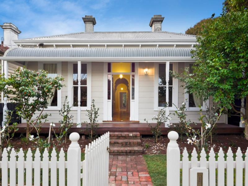 Corrugated Iron Victorian House Exterior With Picket Fence