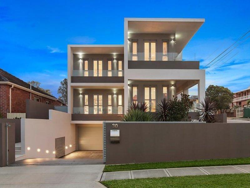 State-of-the-art family home in waterside location 一流的海滨家庭住宅 这套一流的家庭住宅位于特有的海滨,可观赏延伸至城市边缘的美景,这绝对是整片区域最完美的现代住宅。住宅地理位置优越,临近商店和一流学府。 -设计一流,室内外自然融为一体 -精致的居住空间,均铺有大理石瓷砖,带有地暖 -私人庭院,游泳池,外加设施齐全的户外厨房 -中央厨房包括步入式餐具室和Zip水龙头 -四间卧室,每间都带有奢华的套间和私人阳台 -设施齐全的定制书房、家庭影院、健身房和美发