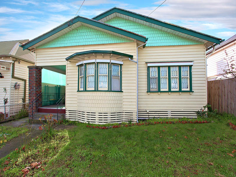 Weatherboard californian bungalow house exterior with ...