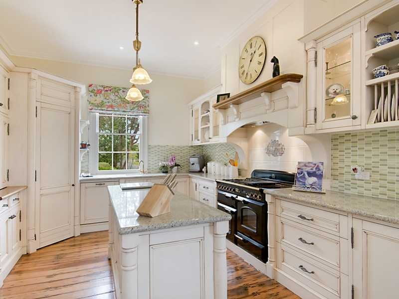 french provincial u shaped kitchen design using floorboards kitchen photo 526329