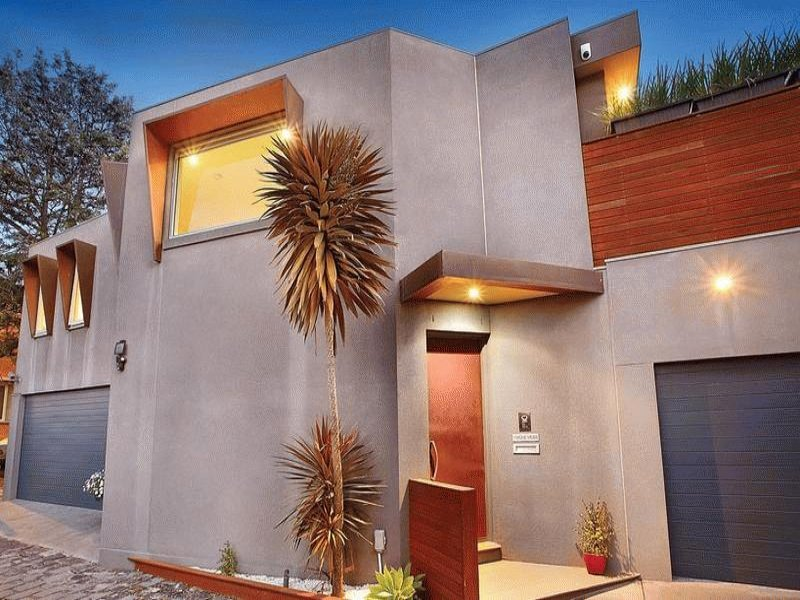 Concrete modern house exterior with porch amp window awnings house