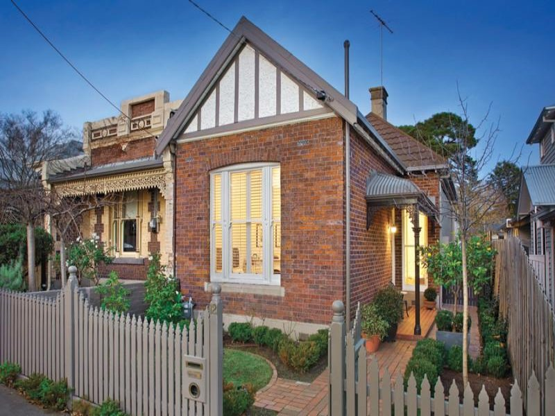 Brick victorian house exterior with picket fence hedging for Brick victorian house