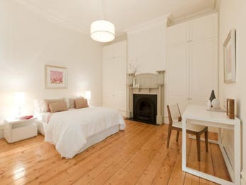 Modern bedroom design idea with floorboards & built-in wardrobe using brown colours - Bedroom photo 482692