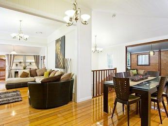 Modern dining room idea with hardwood & louvre windows - Dining Room Photo 489757