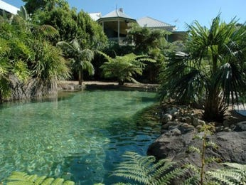 In-ground pool design using pebbles with pool fence & rockery - Pool photo 354799