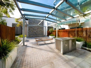 Enclosed outdoor living design with bbq area & outdoor furniture setting using tiles - Outdoor Living Photo 977374