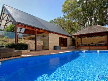 In-ground pool design using stone with cabana & hedging - Pool photo 470227