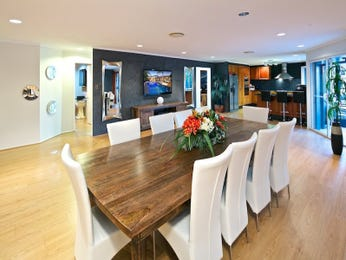 Modern dining room idea with exposed brick & floor-to-ceiling windows - Dining Room Photo 8695853