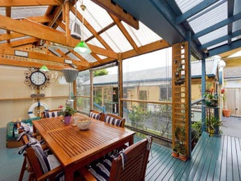 Enclosed outdoor living design with deck & outdoor furniture setting using glass - Outdoor Living Photo 569926