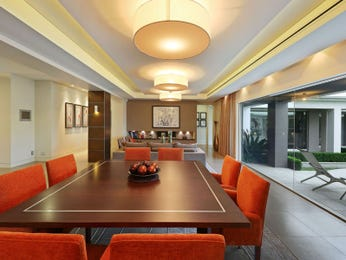 Classic dining room idea with hardwood & floor-to-ceiling windows - Dining Room Photo 8302513