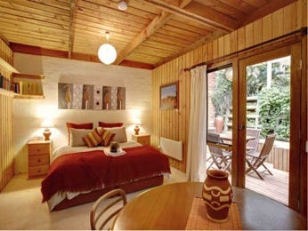 Country bedroom design idea with cane & french doors using brown colours - Bedroom photo 431833