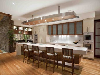 Modern open plan kitchen design using floorboards - Kitchen Photo 7549921