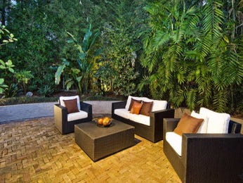 Indoor-outdoor outdoor living design with deck & decorative lighting using grass - Outdoor Living Photo 446996