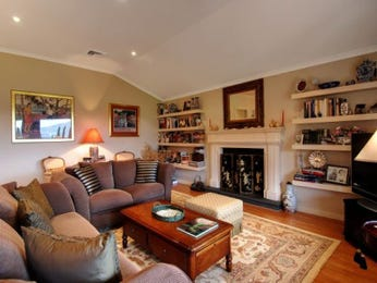 Open plan living room using green colours with carpet & fireplace - Living Area photo 411003