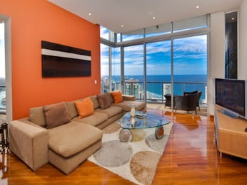 Living Area Ideas With Floorboards And Feature Wall In Orange