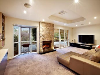 Open plan living room using brown colours with stone & built-in shelving - Living Area photo 100858