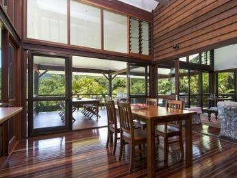 Classic dining room idea with floorboards & floor-to-ceiling windows - Dining Room Photo 7385905