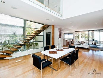 Modern dining room idea with floorboards & floor-to-ceiling windows - Dining Room Photo 7622609