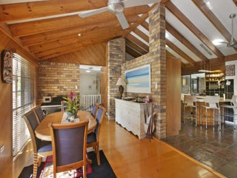 Country dining room idea with exposed brick & exposed eaves - Dining Room Photo 15914085