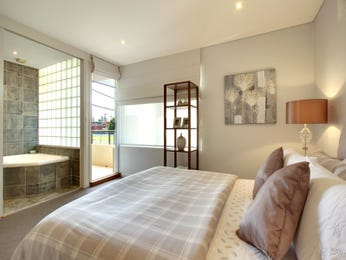 Modern bedroom design idea with carpet & bi-fold doors using cream colours - Bedroom photo 153344