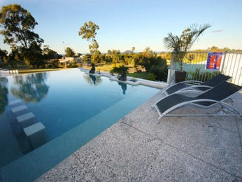 Freeform pool design using slate with glass balustrade & outdoor furniture setting - Pool photo 505002