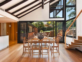Modern dining room idea with floorboards & exposed eaves - Dining Room Photo 17195509