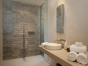 Exposed brick in a bathroom design from an Australian home - Bathroom Photo 154438