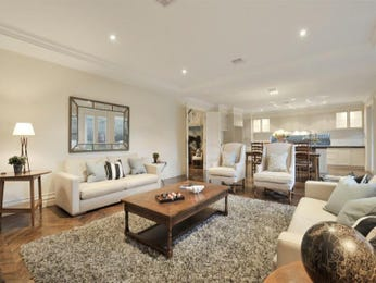 Open plan living room using beige colours with suede & built-in shelving - Living Area photo 156232