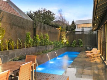 In-ground pool design using tiles with outdoor dining & decorative lighting - Pool photo 440366
