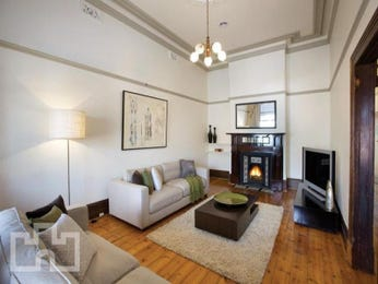 Open plan living room using beige colours with floorboards & fireplace - Living Area photo 158154