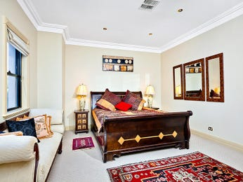 Asian-inspired bedroom design idea with carpet & window seat using brown colours - Bedroom photo 158253