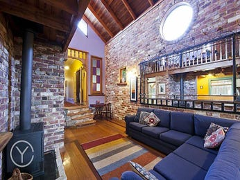 Open plan living room using blue colours with exposed brick & exposed eaves - Living Area photo 708161