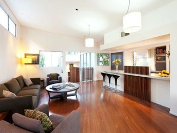 Open plan living room using brown colours with wood panelling & bar/wine bar - Living Area photo 338469