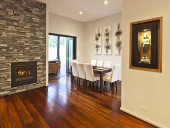 Modern dining room idea with floorboards & fireplace - Dining Room Photo 2131077