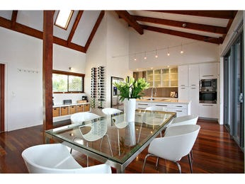 Classic dining room idea with glass & exposed eaves - Dining Room Photo 15113261
