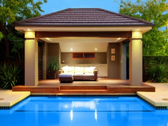 In-ground pool design using stone with cabana & decorative lighting - Pool photo 161999