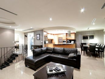Dining-living living room using black colours with leather & staircase - Living Area photo 7550973
