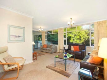 Open plan living room using green colours with carpet & bay windows - Living Area photo 443609