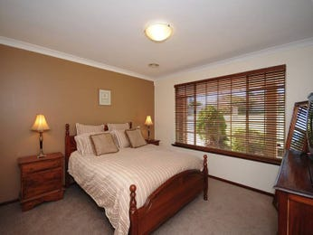 Classic bedroom design idea with tiles & louvre windows using brown colours - Bedroom photo 461803