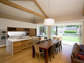 Modern dining room idea with floorboards & exposed eaves - Dining Room Photo 17132517