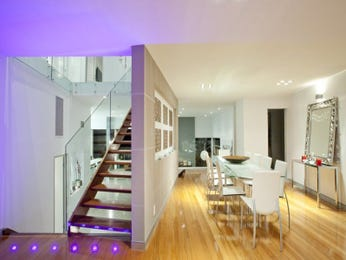 Modern dining room idea with floorboards & staircase - Dining Room Photo 7031037