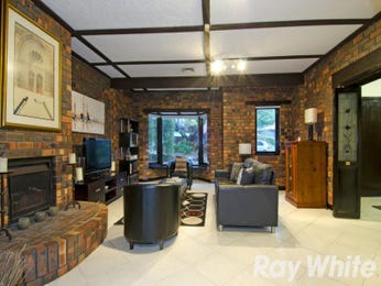 Open plan living room using grey colours with exposed brick & exposed eaves - Living Area photo 2275213