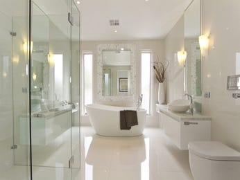 Modern bathroom design with freestanding bath using frameless glass